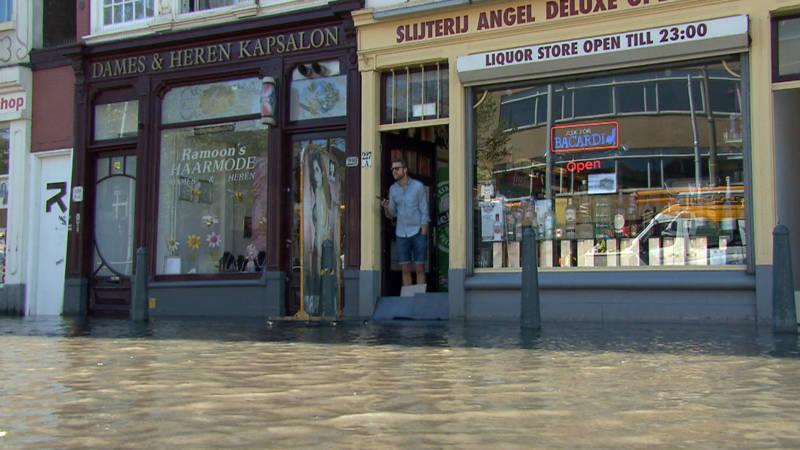 Wateroverlast voor winkels aan spui in den haag nos for Reiswinkel den haag