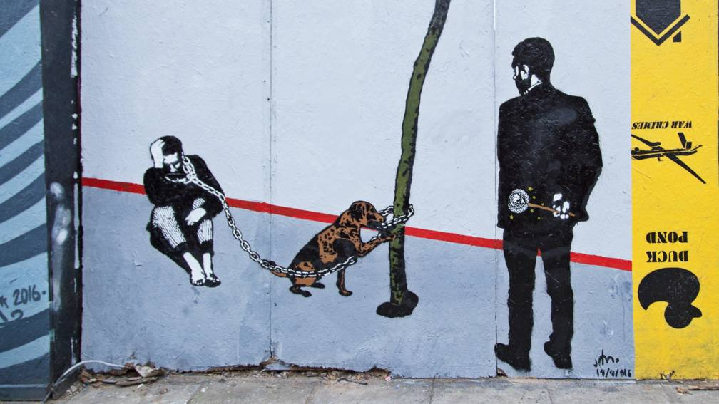 banksy' van jemen: met graffiti wil ik kogelgaten in muren