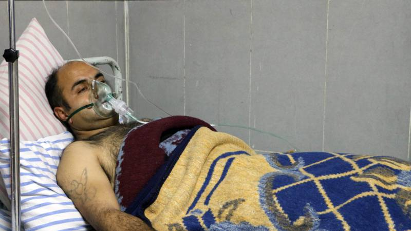 Syrian with breathing problems in Afrin hospital, AFP photo