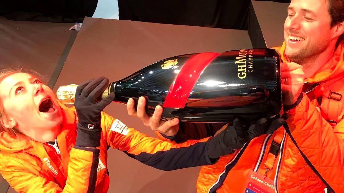 Usain Bolt houdt woord: champagne voor atleten