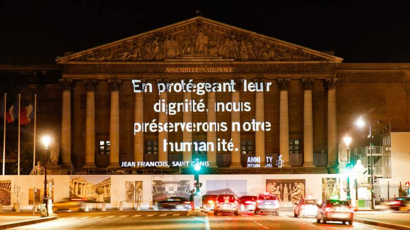 Amnesty protest slogan in Paris: By protecting their [the refugees'] dignity, we preserve our humanity. AFP photo