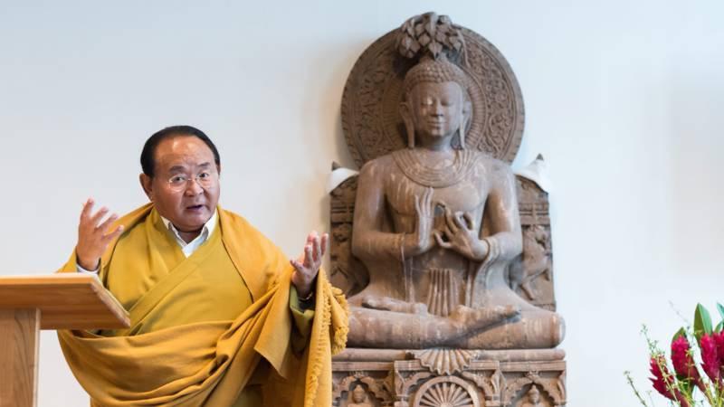 Sogyal Lakar, aka Sogyal Rinpoche, with Buddha sculpture in 2016, EPA photo