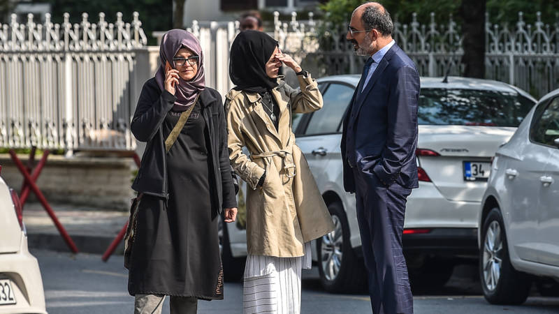 Fiancee of Saudi journalist (left) waiting in vain outside Saudi consulate in Istanbul