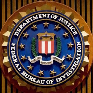 Bekijk details van 4 jaar cel voor oud-FBI-agent die vertrouwelijke documenten lekte