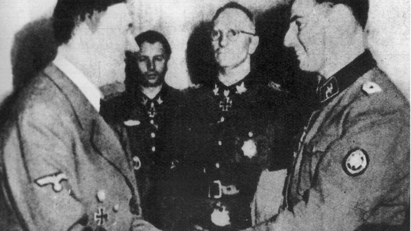 Belgian SS man Degrelle, at right, received by Hitler. AFP/BELGA photo