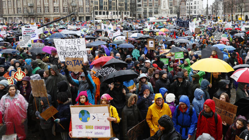 Pro-climate demonstrators gather on the Dam square in Amsterdam, the Netherlands, today, ANP photo