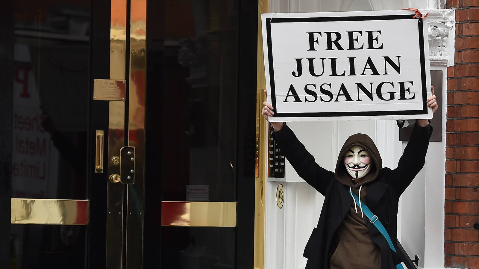 A London demonstrator demands freedom for WikiLeaks founder Julian Assange, ANP photo