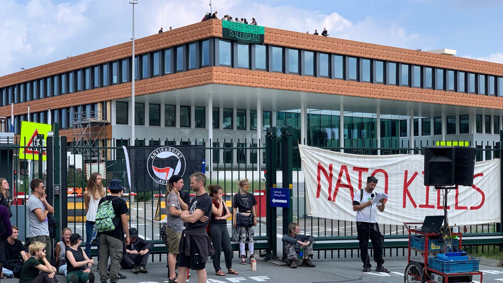 Activists at the NATO building in The Hague, the Netherlands, photo Robert Bas