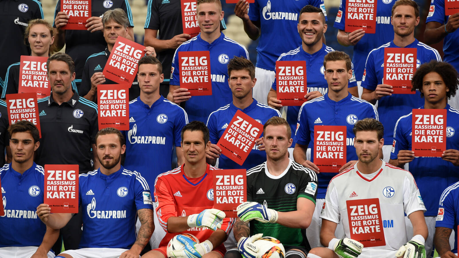 The Schalke team in 2015, with Show racism the red card signs