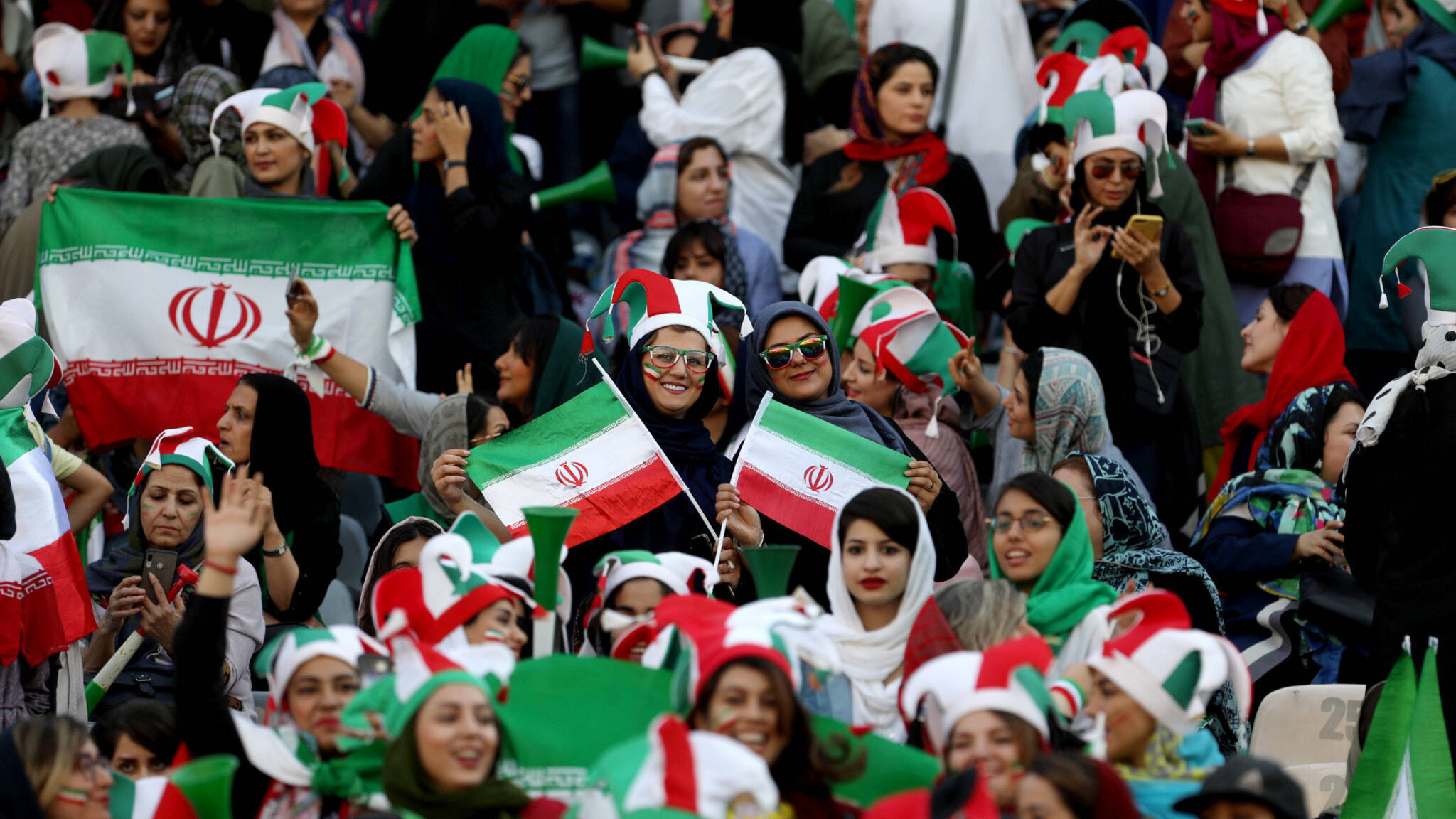 Iranian women supporters at Iran, Cambodia, photo by NOS / Marcel van der Steen