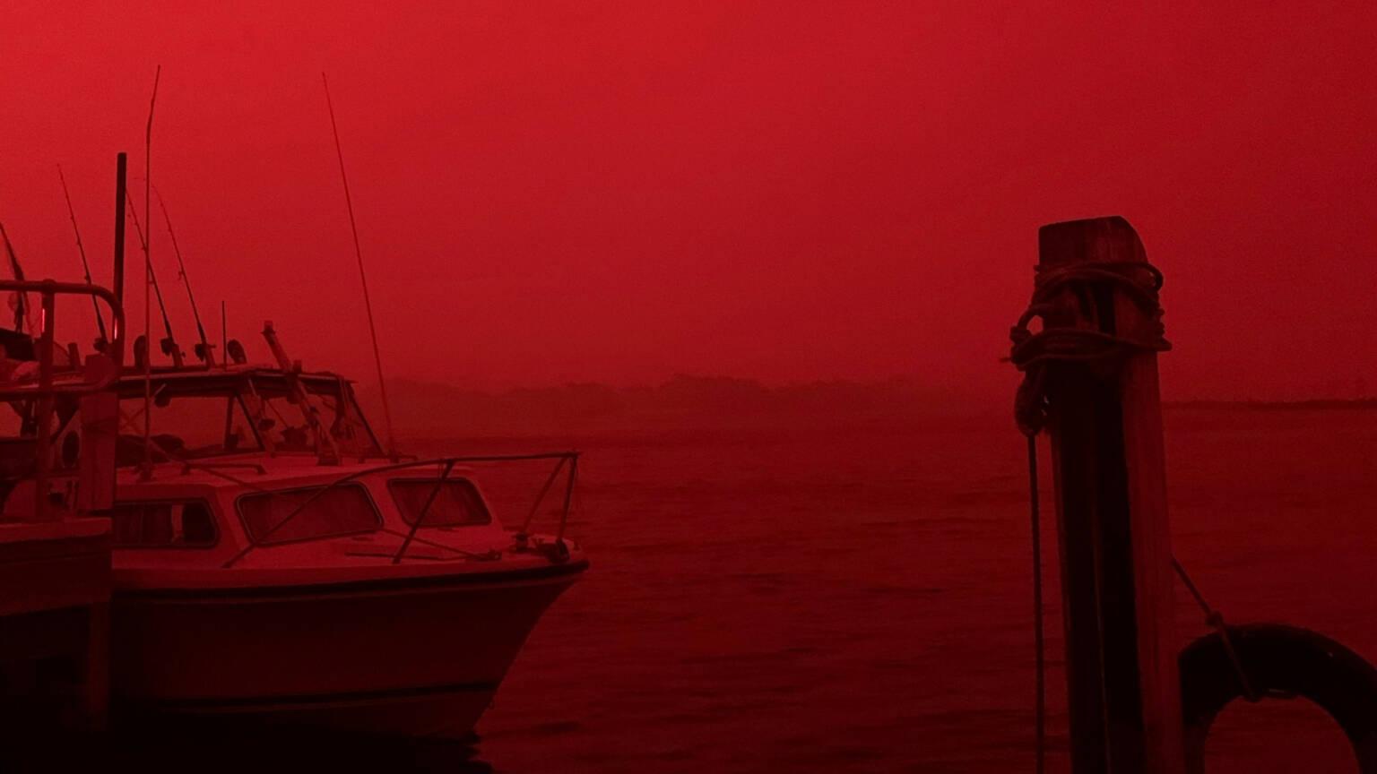 Red bushfire sky over Mallacoota, Australia, photo Jonty Smith/Reuters