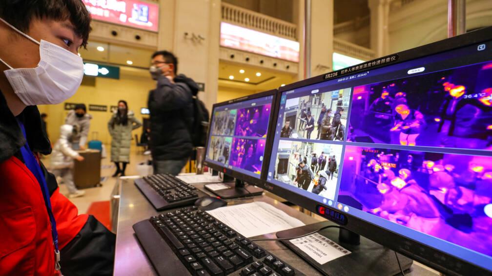 Bekijk details van Wuhan sluit vliegveld en stations om virus, WHO ziet nog geen noodsituatie