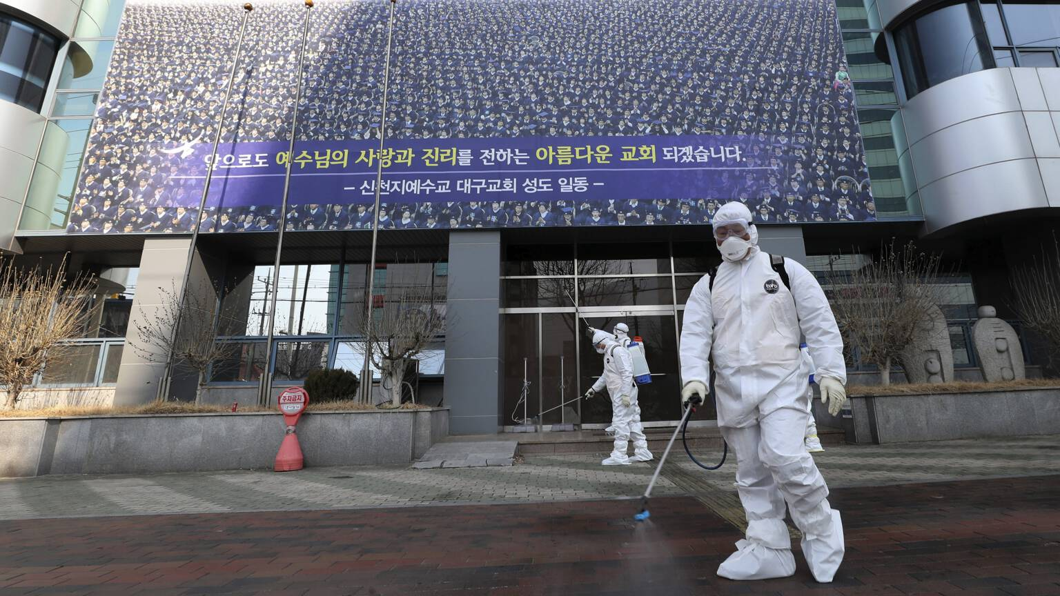 The entrance of the Shincheonji church in Daegu gets coronavirus decontamination, Associated Press photo