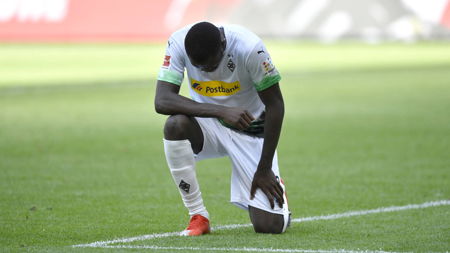 Footballer Marcus Thuram kneels in protest against police brutality in the USA