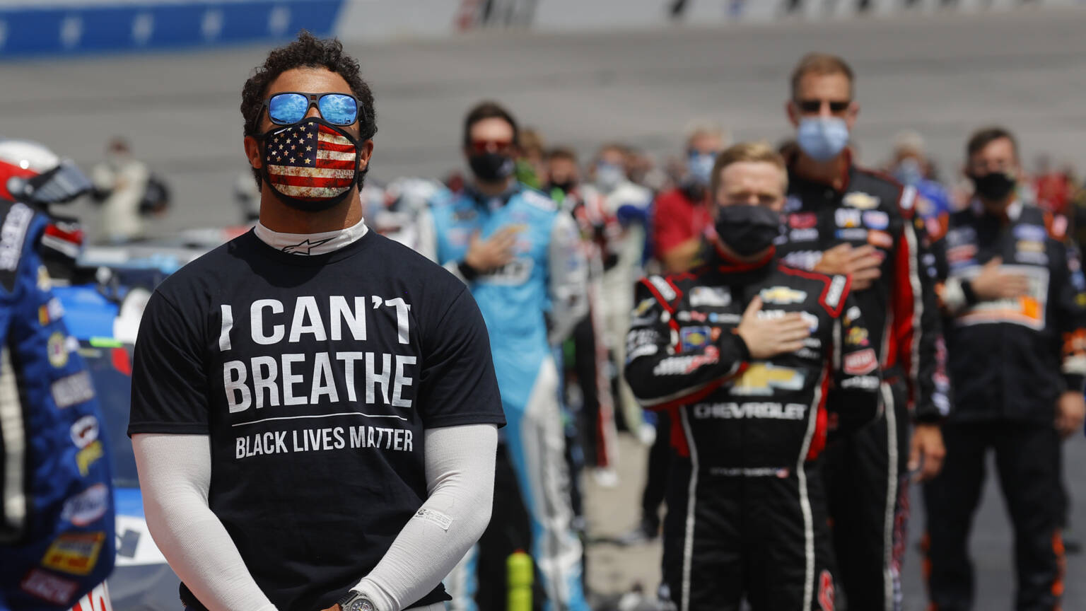 Bubba Wallace (left) wore a T-shirt referring to the death of George Floyd when singing the national anthem before a race on June 6. AFP photo